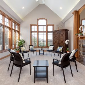 Group therapy room with high ceilings and view of trees
