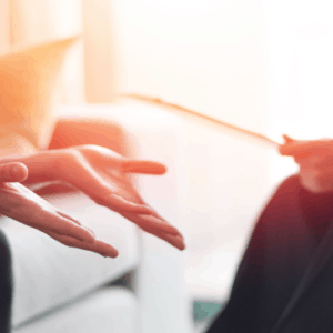 Close up photo of two sets of hands in a therapy session with